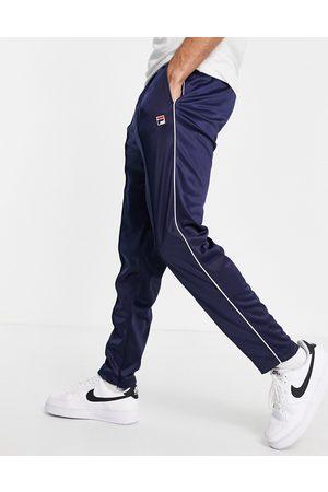 Fila – Terry – Marinblå träningsbyxor med boxig logga