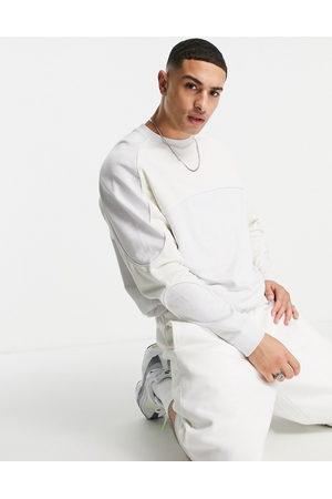 ASOS – Blockfärgad sweatshirt i oversize med kantrand
