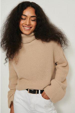 NA-KD Kvinna Stickade tröjor - Stickad tröja med vida ärmar och hög krage