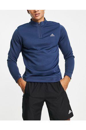 adidas – Marinblå sweatshirt med dragkedja vid halsen