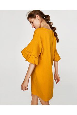 klänning volangärm